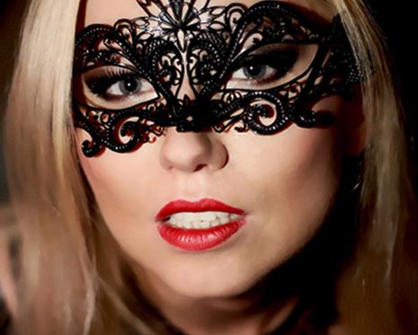 mistress wildfire wearing latex mask