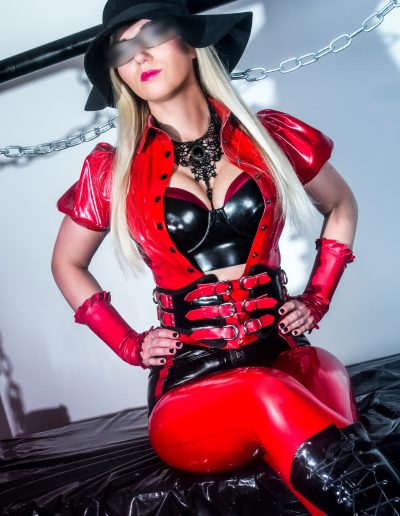 red latex outfit worn by stunning blonde mistress