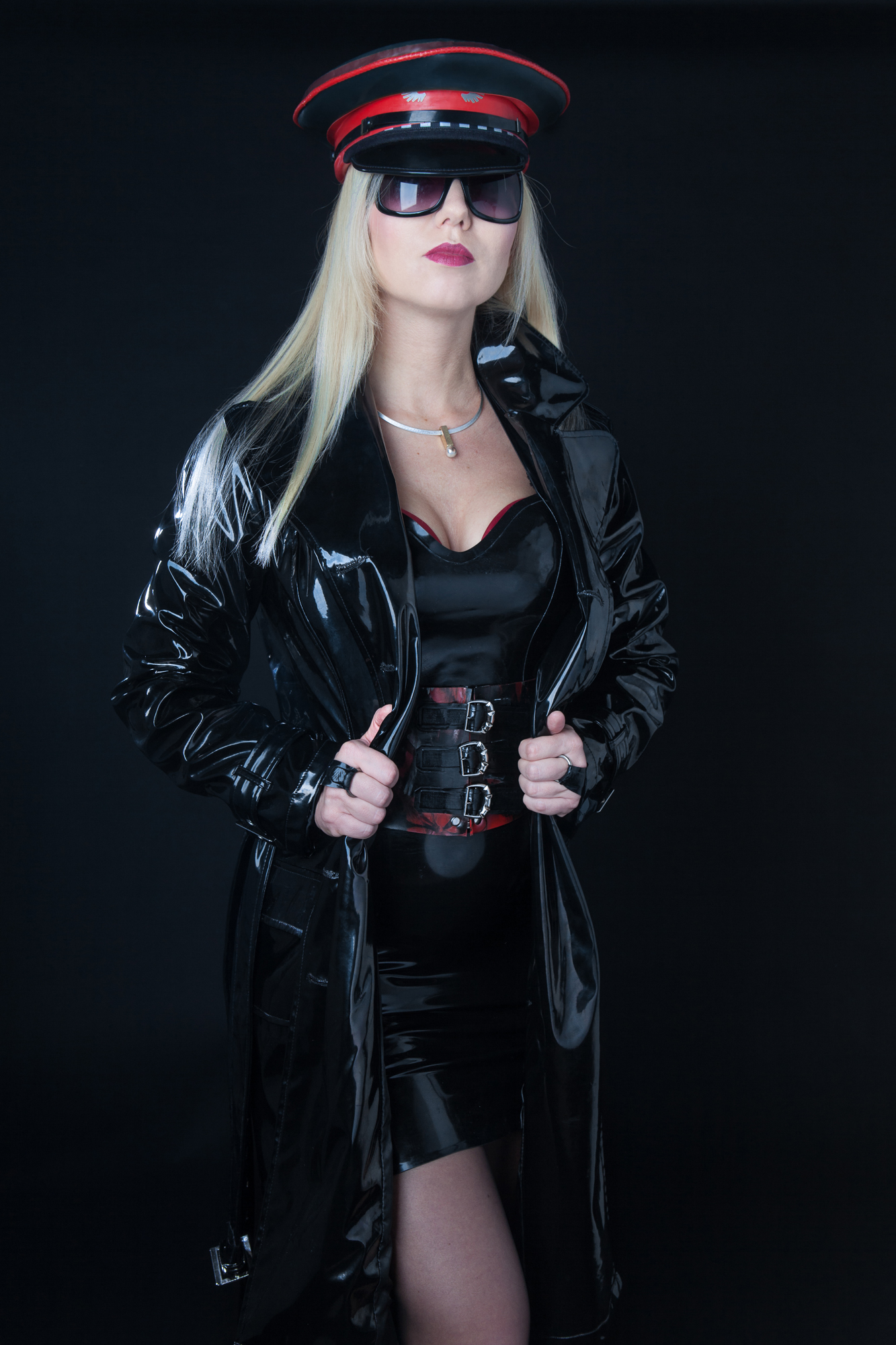 blonde dominatrix wearing PVC trench