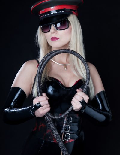 London Mistress Wildfire holding a bill whip