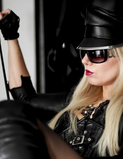serious leather mistress with crop