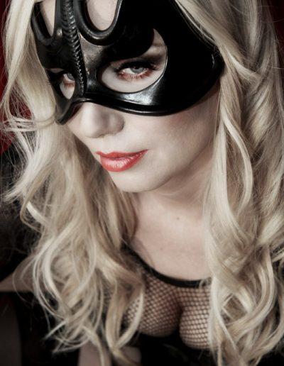 mistress wildfire wearing a beautiful leather mask